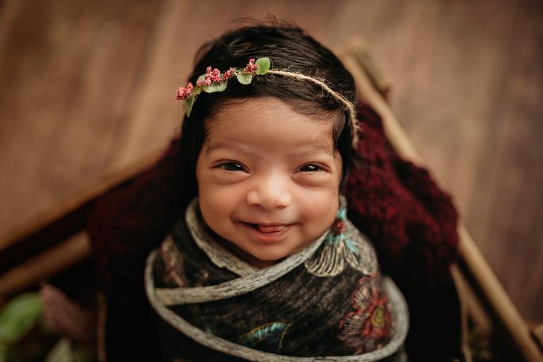 smiling newborn raleigh newborn photographer