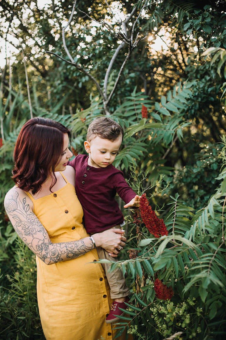 mom and son looking at flowers