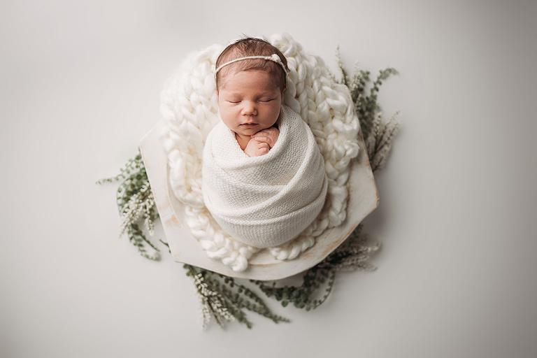 swaddled newborn apex